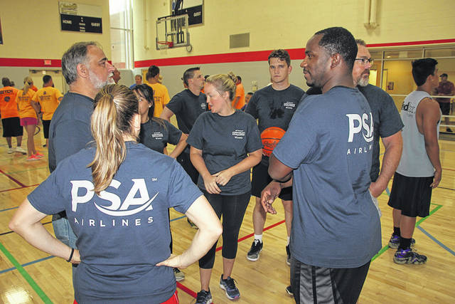 The team from PSA Airlines plots strategy before the basketball challenge during the 30th Annual Vandalia Corporate Challenge.