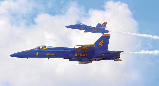 Mike Ullery | AIM Media Midwest A pair of Blue Angels FA-18 aircraft approach show center on Sunday.