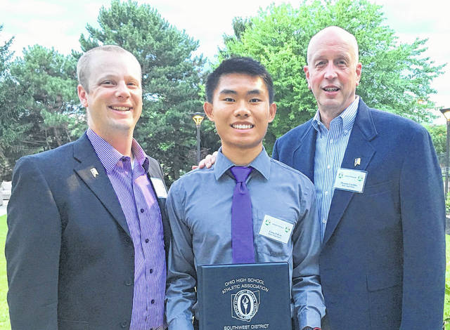 Butler High School senior Long Fa Lin (center) was honored by the Southwest District Athletic Board with a Dale E. Creamer Honorary Scholarship. He is pictured with Butler Athletic Director Jordan Shumaker (left) and Principal Thomas Luebbe.