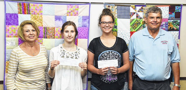 Vandalia Sister Cities awarded scholarships to three students at its June 13, 2018 meeting. Pictured left to right are Scholarship Committee member Elaine Johnson, scholarship recipients Jenna Albezreh and Camryn Snapp, and Sister Cities President David Starline. Scholarship recipient Grace Cope was unable to attend the presentation.