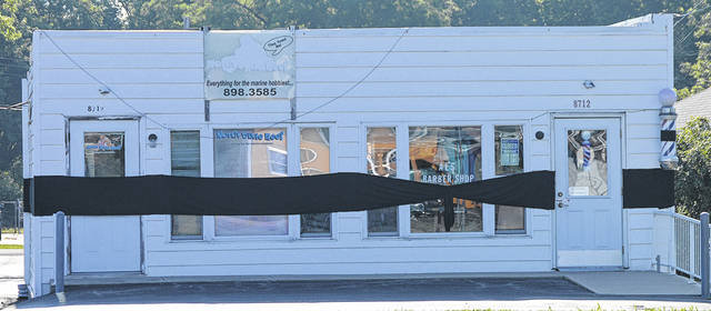 Al's Barber Shop, located at 8712 N. Dixie Drive in Butler Township, was draped in a black ribbon on Tuesday to mourn the shop's namesake, Al Larger, who died at age 96.