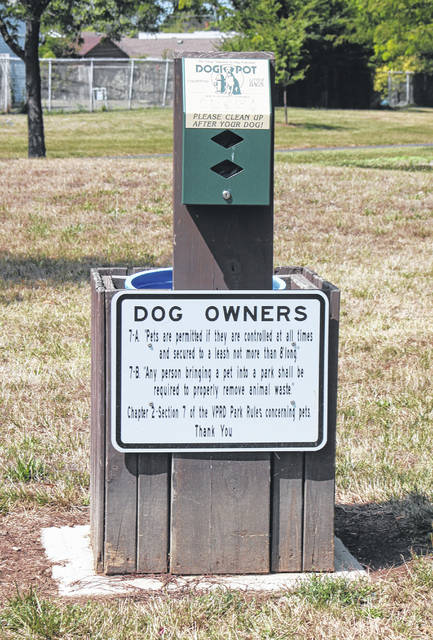 Clean-up stations like this one located at Robinette Park provide dog owners with plastic bags to clean up after their pets. In your neighborhood, bring along a plastic grocery sack to handle any messes along the way.