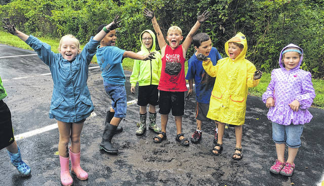 Children enjoy mud fun at Aullwood during Summer Earth Adventures.