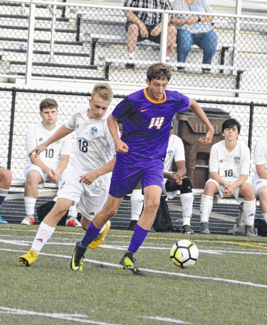 Keegan Hadder (14) moves the ball versus a Skyhawk defender during Butler's 2-0 win over Fairborn on Tuesday.