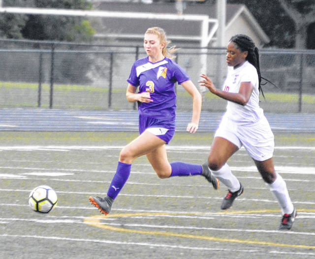 Ella Neely advances the ball upfield against Trotwood-Madiosn.
