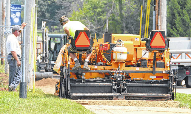 Vandalia Public Works employees worked on constructing an asphalt walkway in front of the Vandalia Recreation Center and westward toward Morton Middle School on Thursday, Aug. 2.