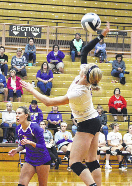 Alyssa Burley goes for one of her 18 kills in a loss to Northmont on Monday.