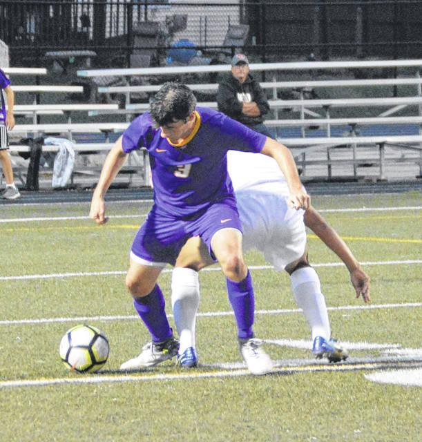 Butler's Clay Colton battles for possession during Troy's 1-0 win at Butler on Tuesday.