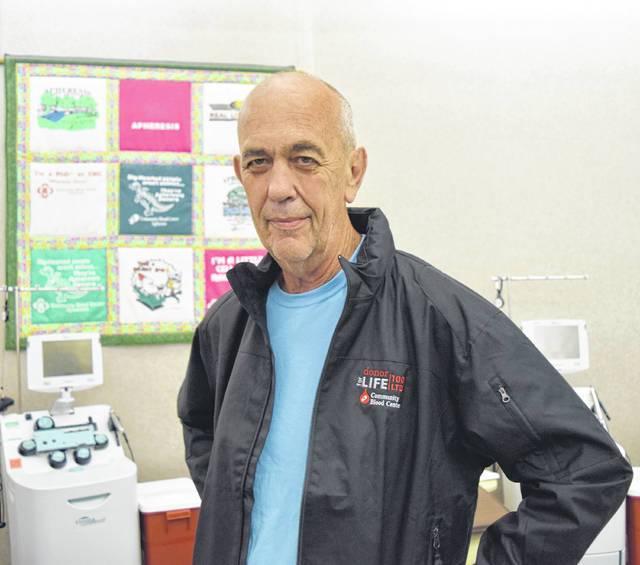 Vandalia's Mike Demuth made his 100th lifetime donation at the Community Blood Center on Aug. 29.