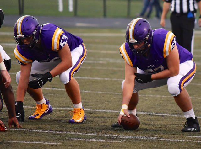 Butler center Ben Sipos (67) prepares to snap the ball beside Charlie Dent (63) as Butler defeated Wilmington 38-12 in Week 3 at Memorial Field at Miami Valley Athletic Complex in the Aviators' home opener.