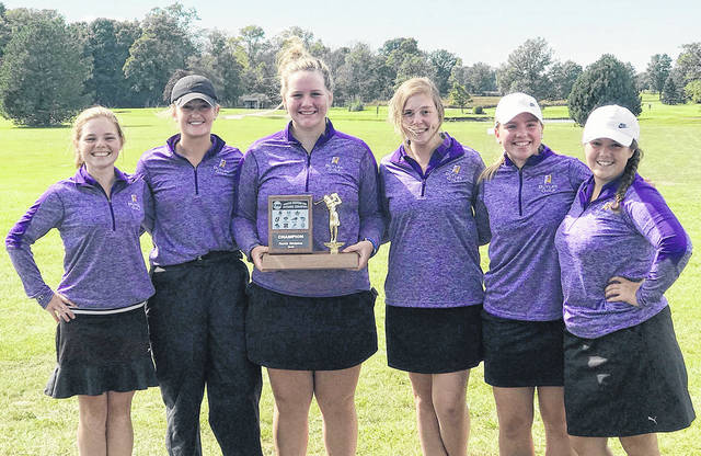 The Butler girls golf team, pictured left to right, Hailee Perry, Lexi Crawford, Breanne Kroeker, Savanna Dunlevy, Allison Zebney, and Hailey Zeller, show off the Greater Western Ohio Conference North division trophy on Wednesday at Beechwood Golf Course in Arcanum.