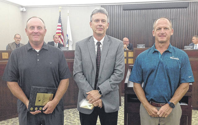 Miami Valley Risk Management Association Executive Director Tom Judy, center, presented awards to Vandalia's Parks and Recreation Director Steve Clark, left, and Public Works Director Rob Cron, right, in recognition of those department's having zero loss status in 2017.