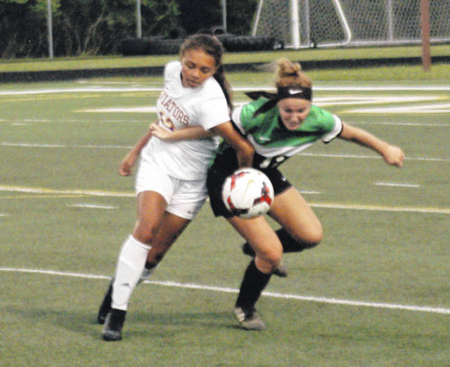 <strong>Butler&#8217;s Mya Stammen battles Addison Yingling for control during the first half.</strong>