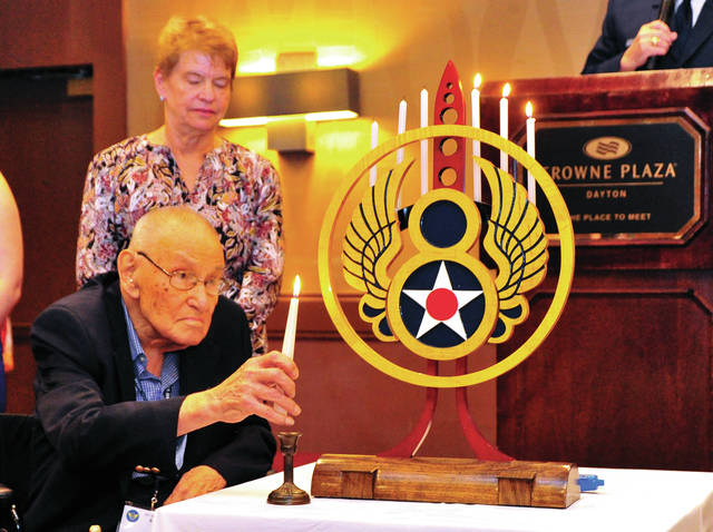 Mike Ullery | Daily Call Robert Doolin, 102, lights a candle during a remembrance ceremony at the Crown Plaza Hotel in Dayton on Saturday. Doolin, a member of the 92nd Bomb Group was one of more than 60 surviving members of the famed 8th Air Force who gathered for a reunion in Dayton last week.