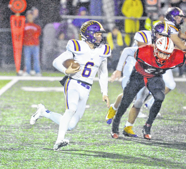 Josh Brown|AIM Media Butler's Mason Motter runs the football Friday against Tippecanoe.