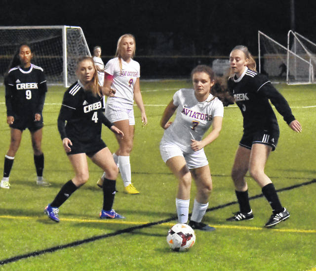 Josie Stiver (7) attempts to gain possession as Bailey Walko (9) looks on.