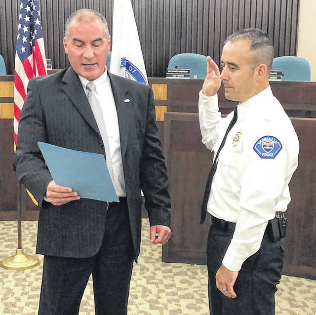 Vandalia City Manager Jon Crusey (left) administered the oath of office to Vandalia Police Lieutenant Ben Walker on Wednesday morning.