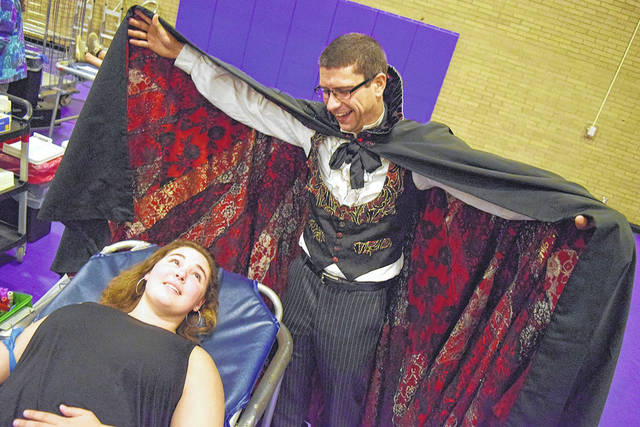 Butler High School Donor Abby Hern poses with Dracula during a blood drive at Butler High School.