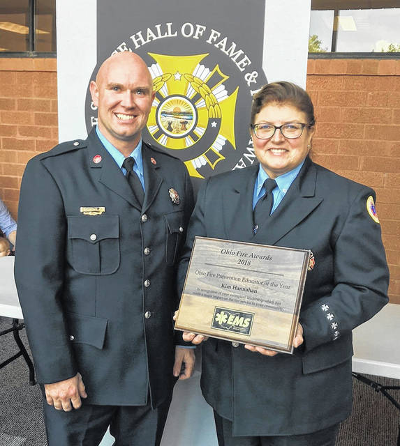 Former Vandalia Fire Prevention Officer Eric Cook stands with Vandalia's retired Code Enforcement Officer Kim Hannahan after she received the Ohio Fire Prevention Educator of the Year award.