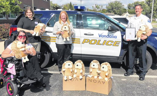Melissa Milinovich delivered Herbie stuffed animals to Vandalia's first responders on Tuesday. The Herbies are given to children who need comfort.