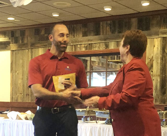 During the club's regular meeting October 9, Vandalia-Butler Optimist Club President Matthew Neely was recognized for sponsoring one of the club's newest members, Mark Schertzinger. Ann Morrissey, Optimist lieutenant governor, is pictured presenting Neely with a pin to commemorate his recruitment of Schertzinger, who serves as executive director of Brookhaven Retirement Community, Brookville.