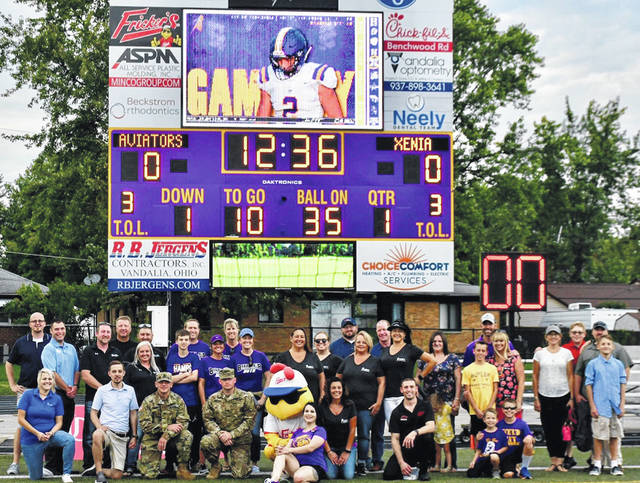 "Sponsors of Butler's new scoreboard gathered for a photo prior to the Aviators' overtime win over Xenia at Memorial Field at Miami Valley Hospital Athletic Complex.<style type=""text/css""></style>"