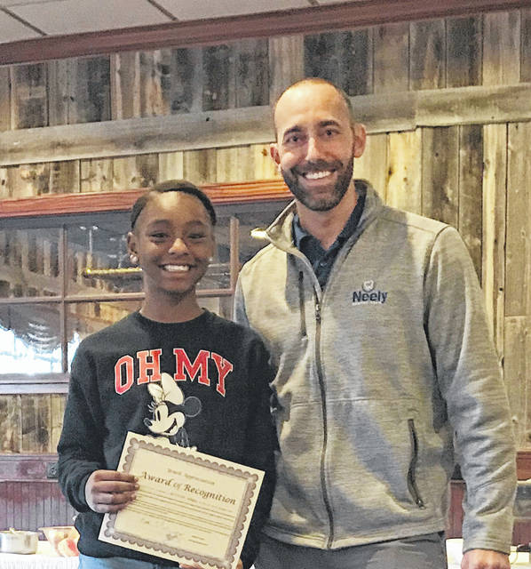 British Adams was the Morton Middle School nominee for the Optimist Club's 2018 Youth Appreciation Award. She is pictured with Matthew Neely, President of the Vandalia-Butler Optimist Club.