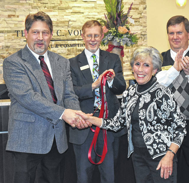Vandalia Mayor Arlene Setzer congragulates Dr. Thomas Volck on the dental practice's new location.