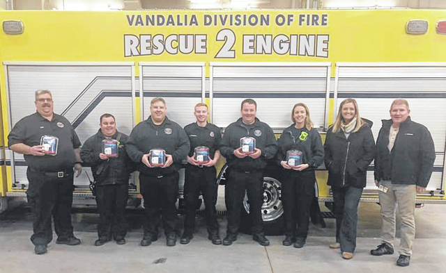 Members of the Vandalia Division of Fire show off Carbon Monoxide detectors that were donated by Inteva Products. The donated detectors will be used to assist those who cannot afford to purchase one.