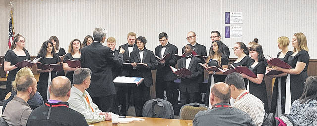 The Vandalia-Butler Optimist Club took a road trip to Butler High School for their regular meeting on Tuesday to hear a performance of the Butler Chamber Choir under the direction of Kevin Wilson. The Optimist Club meets for lunch each Tuesday with most meetings at Celebrations II.