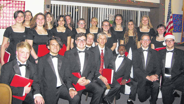 The December 13 dinner meeting of the Vandalia Lions Club was their Christmas Guest Nite. Entertainment was provided by the 20-member Vandalia-Butler High School Chamber Choir. This is a select group from the larger Symphonic Choir. The program presented by this talented group, under the direction of Mr. Kevin Wilson, included selections ranging from Folk Tunes to traditional, specially arranged, Christmas Carols, all with beautiful tones and harmonies.