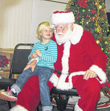 "On Saturday December 8 the Vandalia Lions Club hosted their Annual Breakfast With Santa at the Senior Citizens Center. Breakfast included pancakes, scrambled eggs, sausage, bacon, orange juice, and coffee. There were 120 attendees plus the Lion Hosts, including 50 children who had their picture taken with Santa and received a copy of the photo and a gift. Based on a poll taken by Santa, all the children have been ""nice,"" there were no ""naughties."" Everyone seemed to have a good time."
