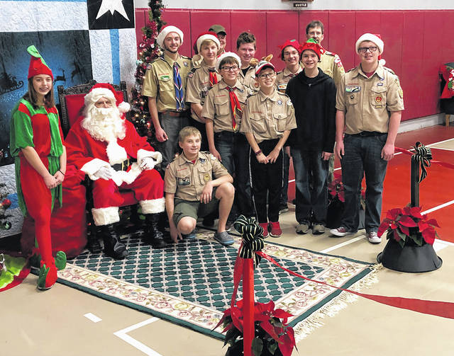 Boy Scout Troop 466 assisted Santa at the annual St. Christopher breakfast on Saturday, Dec. 1. The Scouts host games while the children wait their turn to talk to Santa.