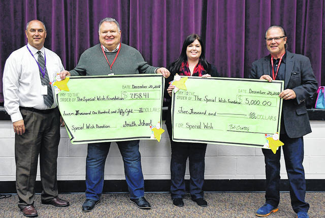 Students and staff of Smith Middle School have supported the Special Wish Foundation for over 30 years, and on Thursday made a check presentation to the organization. Through school fundraisers and a $5,000 match by donor Bob Crotty, the donation for 2018 was $12,158.41, enough to grant three wishes. In the past three years, Smith students, staff, and Crotty have donated over $30,000 to the Special Wish Foundation.