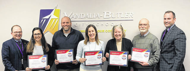 Vandalia-Butler Board of Education members received cerificates on Tuesday in honor of School Board Recognition Month. Pictured left to right are Treasurer Eric Beavers, Board Member Missy Pruszynski, Vice President Rodney Washburn, President Holly Herbst, Board Members Mary Kilsheimer and Kent Zimmerman, and Superintendent Rob O'Leary.