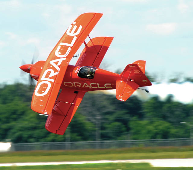 National Aviation Hall of Fame enshrinee and former world aerobatic champion Sean Tucker goes to a knife-edge less than 20 feet from the ground. Tucker will return to the 2019 Vectren Dayton Air Show as part of Team Oracle.