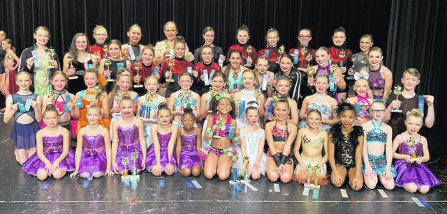 Members of Dance Expressions are pictured left to right in first row Alexandra Kreitzer, Lexi Hayslett, Lauren McBride, Allison Oakes, Simora Singleton, Ja'Tara Jones, Fable Walton, Paige Gallup, Alyssa Holderman, Davonna Harris, Bella Runyon, Zoey Renner; second row Zoey Grimes, Taylor Harris, Alyssa Stratman, Keira Wagner, Mayci Minnich, Reagan Downey, Hayden Farst, Emma Cox, Hailey Hayes, Ava Williamson, Becca Atkinson, Brayden Hanf; third row Annabel Lozan, Taryn Smith, Logan Druck, Jenna Dietz, Molly Armentrout, Kara Landis, Sofia Valdespino, Carlee Schroeder, Aubrey Gillespie, Kiersten McBride, Anna Sciarretti; fourth row Avery Gunderson, Serena Uloho, Heather McBride, Izzy Brooks, Makenzie Detrick, Haleigh Gross, Brianne Lytle, Maritza Scott, Sydney Lawler. Not pictured is Addison Caldwell.