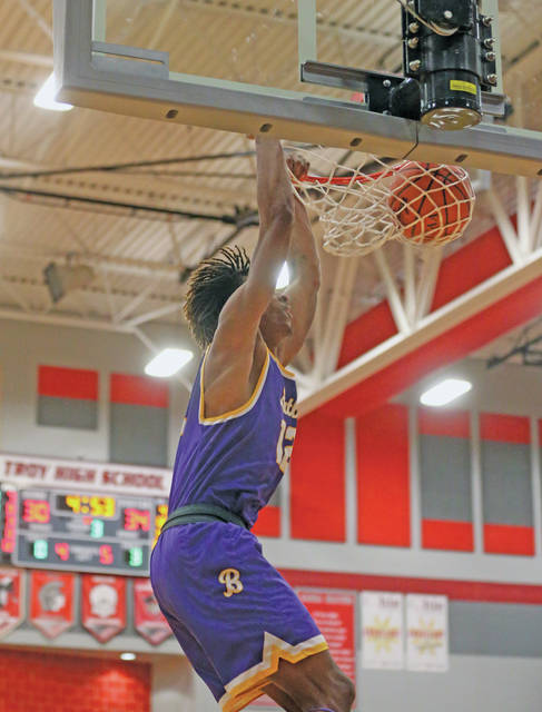 Lee Woolery Miami Valley Sunday News Butler's Bryant Johnson dunks in transition Friday against Troy.