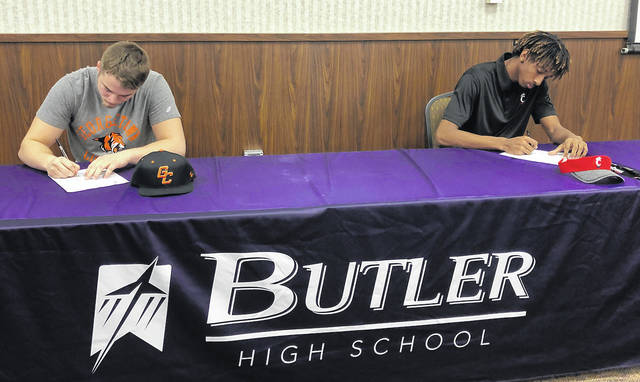 Butler football players Nick Coyle, left, and Bryant Johnson signed National Letters of Intent to play football on Wednesday, February 6. Coyle will play at Georgetown (KY) University and Johnson at the University of Cincinnati.