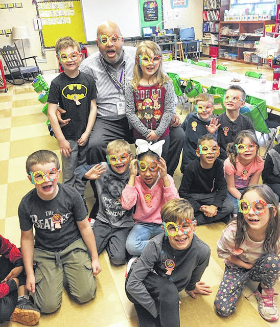 "Principal Garry Martin joined students at Demmitt Elementary School last week in celebrating the 100th day of school. Students wore special ""100"" glasses as they celebrated the milestone of the school year."