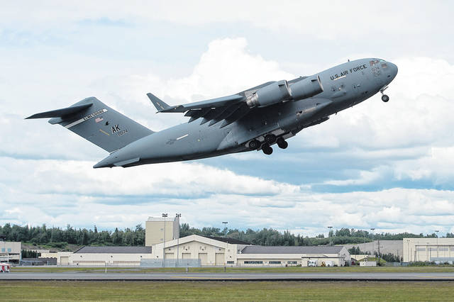 The U.S. Air Force C-17 Globemaster III will perform a flight demonstration at this summer's Vectren Dayton Air Show. The C-17 pictured here takes off during the Arctic Thunder Open House Special Needs and Department of Defense Family Day at Joint Base Elmendorf-Richardson, Alaska, June 29, 2018. (U.S. Air Force photo by Alejandro Peña)