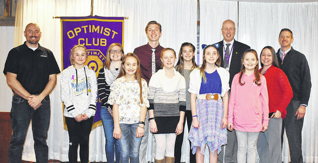 The Optimist Club of Vandalia-Butler recently announced the winners of the 2109 Essay Contest. Pictured back row, left to right, are judge Justin Spivey, Emma Pruszynski, Hailee Perry, Gabe Warren, Addison Williams, judges Tom Luebbe and Kurt Althouse; front row, left to right, Molly Pruszynski, Ava Heidenreich, Taryn Roos, Sydney Wolpert and judge Anaka Johnson.