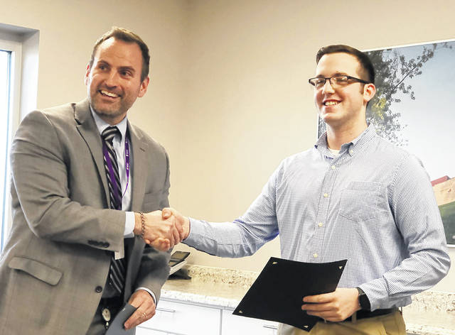 Casey Petrae, right, was presented an Aviator Achievement Award by Superintendent Rob O'Leary in recognition for his being chosen as the Butler High School winner of the Dayton LaSertoma Club's Youth Service Award.