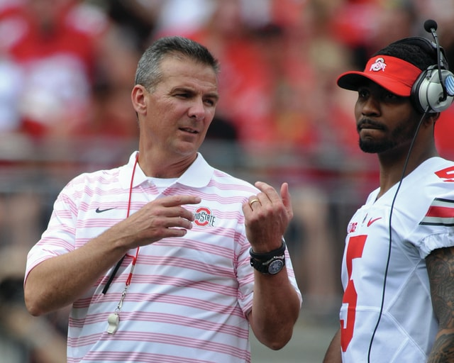 File photo courtesy Lee Woolery/Speedshot Photo Ohio State coach Urban Meyer talks to quarterback Braxton Miller on the sidelines during the team's spring game at Ohio Stadium earlier this year.