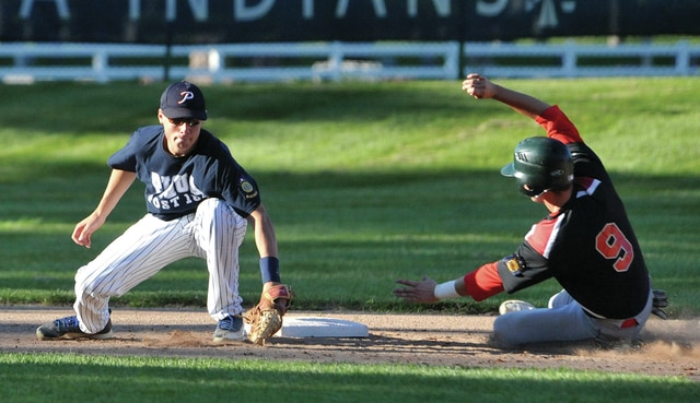 Mike Ullery | Civitas Media Troy Post 43's Brandon Nesbitt steals a base as Piqua Post 184's Austin Arnold moves to apply the tag Tuesday night at Hardman Field.