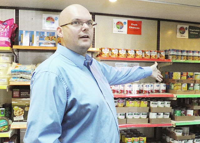 Anthony Weber | Troy Daily News The New Path Executive Director Bill Lutz discusses the various ministries offered, including the food pantry and Time Bank recently.