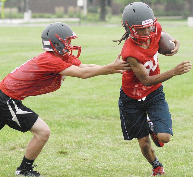 Anthony Weber | Troy Daily News Members of the Troy football team go through camp drills earlier this summer. The Trojans will officially begin practice Aug. 3.