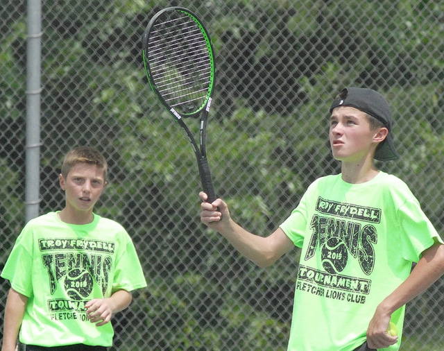 Anthony Weber | Troy Daily News Nate Brumbaugh (left) and Nate Kleptz discuss strategy during the Thomas Frydell Memorial Junior Tennis Tournament at Troy Community Park.