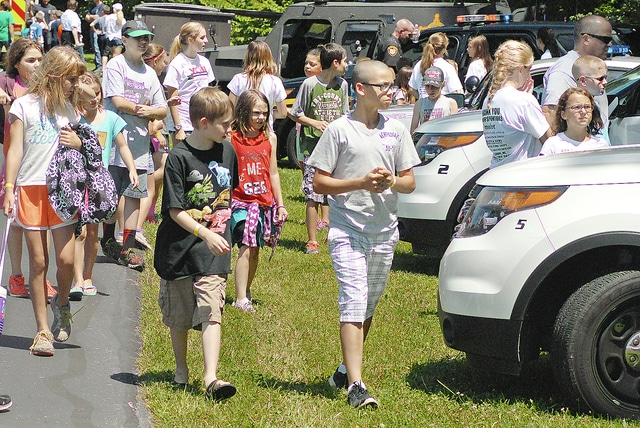 Anthony Weber | Troy Daily News At least 105 campers, third through sixth grade, participated in all-day activities at Redman's Picnic Grounds during the annual Sheriff's Camp in Troy, sponsored by the Miami County Sheriff's Office. Campers also were able to explore various emergency vehicles including four K-9 units from different agencies.