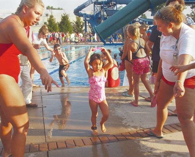 Dave Fornell | For the Troy Daily News Lifeguards and volunteers help competitors in the 4-6 year old age group out of the pool at the Troy Aquatic Park and on to the next event during the Troy Kids Triathalon event Saturday in Troy.